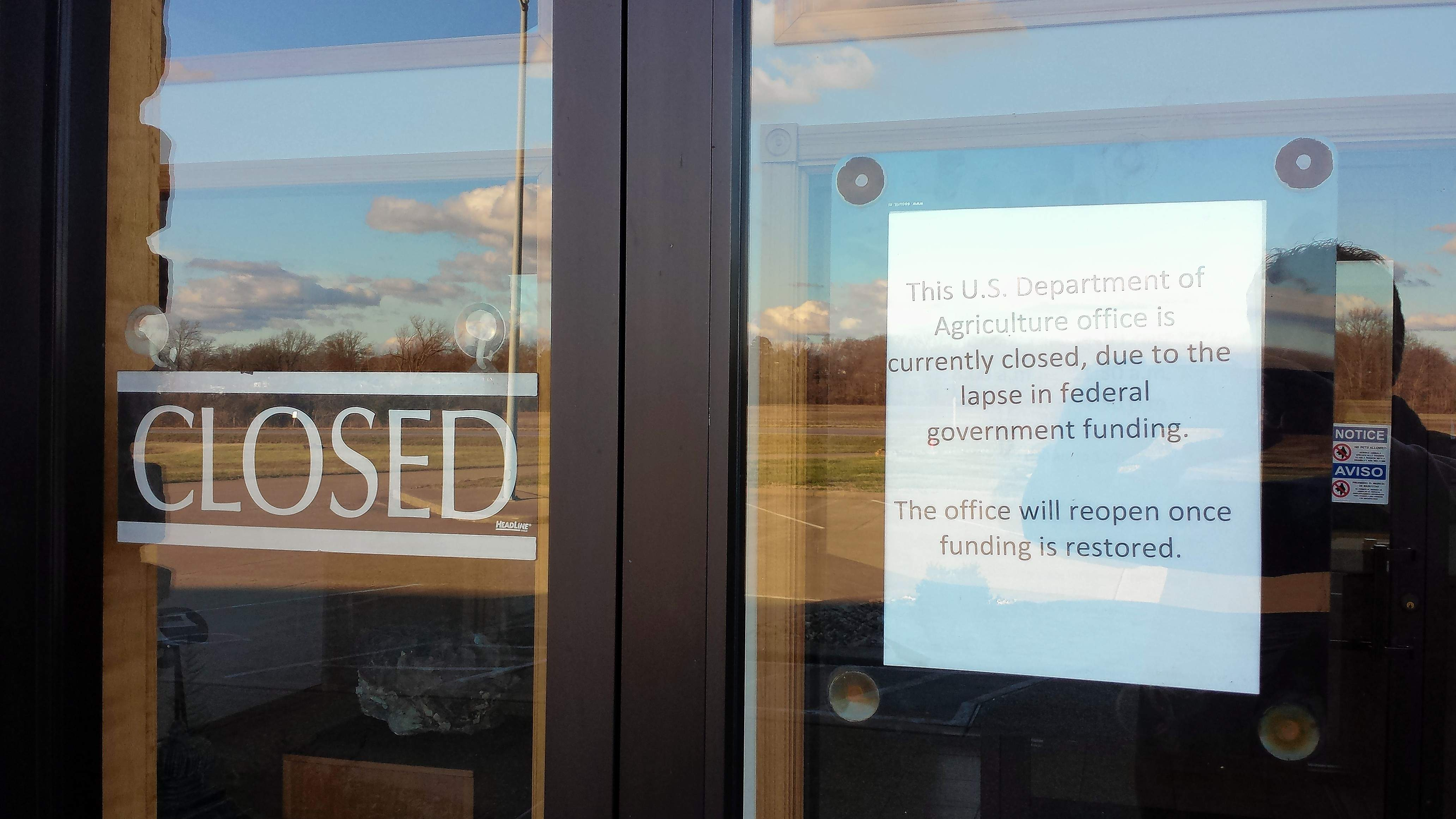 A sign on the door of the Shawnee National Forest headquarters in Harrisburg informs visitors of the government shutdown and its effect on forest areas.