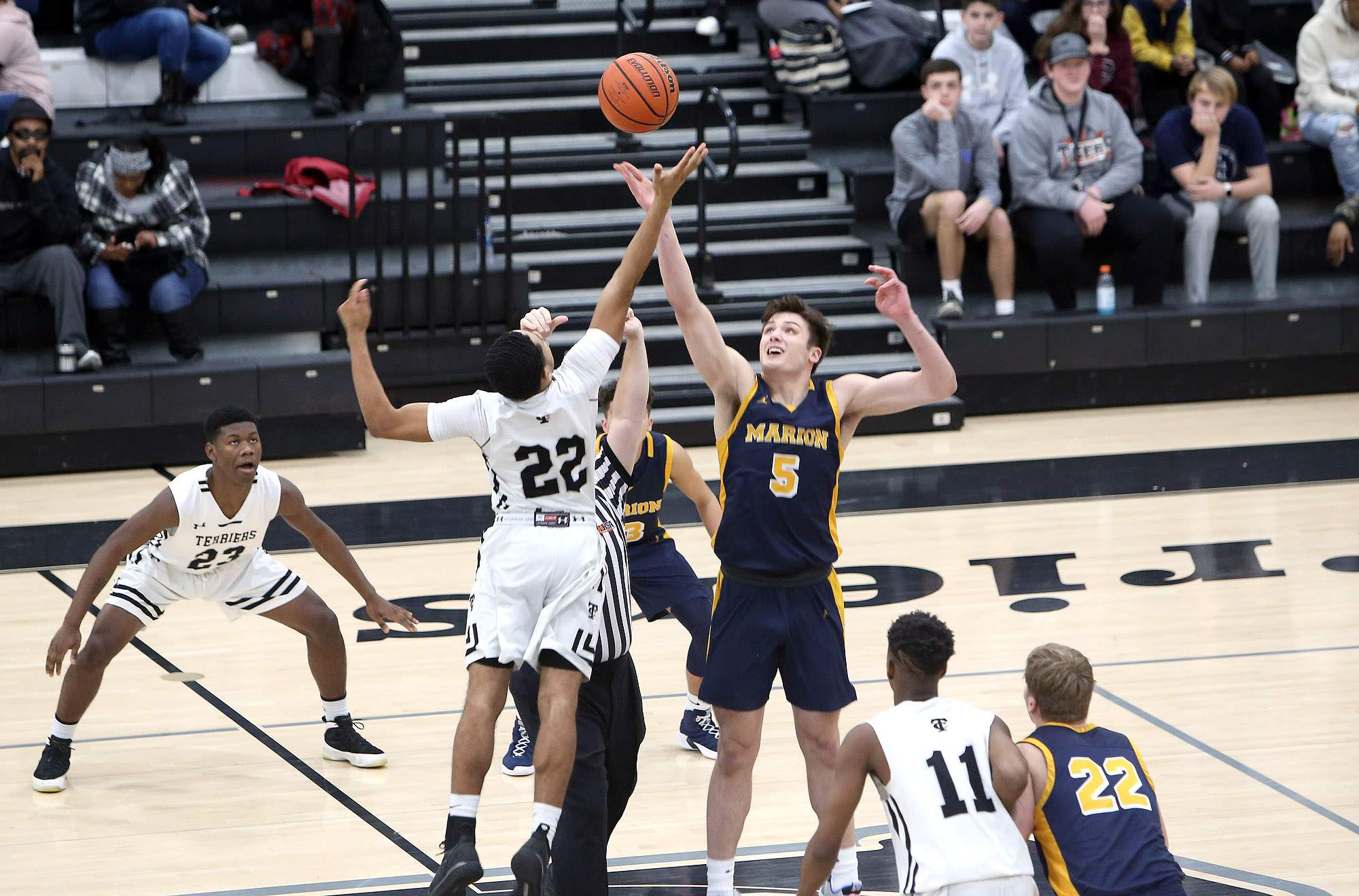 Marion's Jackson Connor and Carbondale's Jakeba Burleigh compete for the opening tip Saturday.