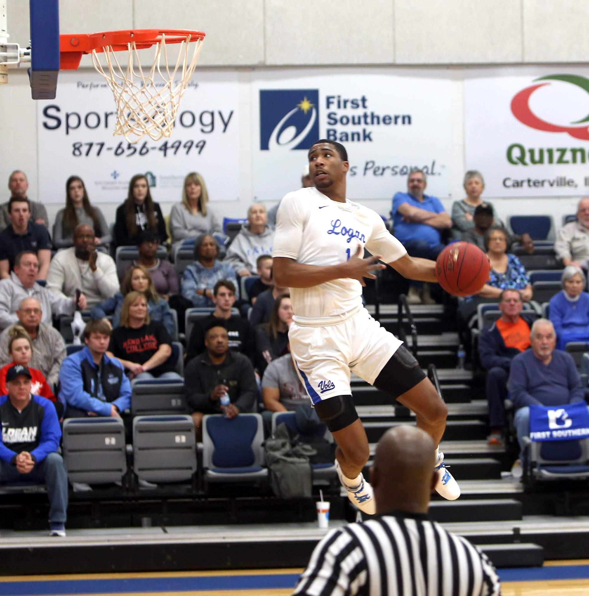 Logan freshman Jayden Scrubb lifts off for a windmill dunk Saturday.