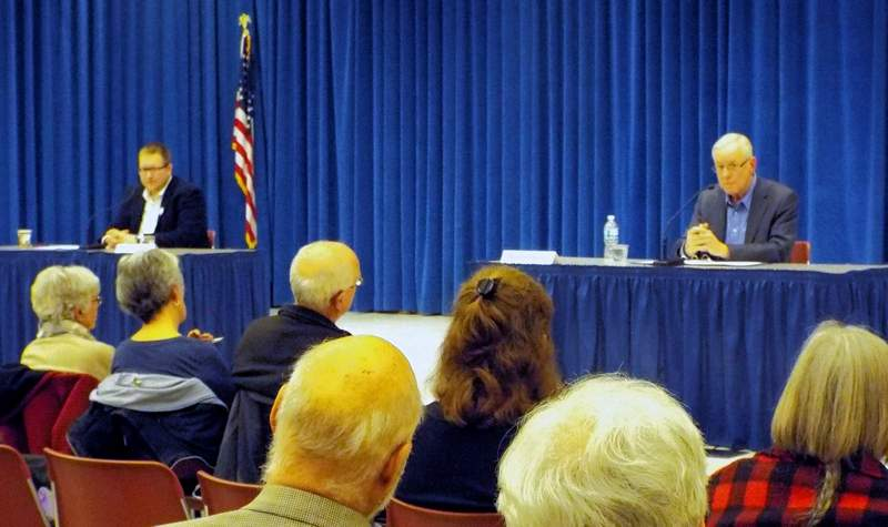 Carbondale mayoral candidates Nathan Colombo (left) and incumbent Mike Henry answer questions during the Women for Change community forum Thursday, March 7 at the Civic Center.
