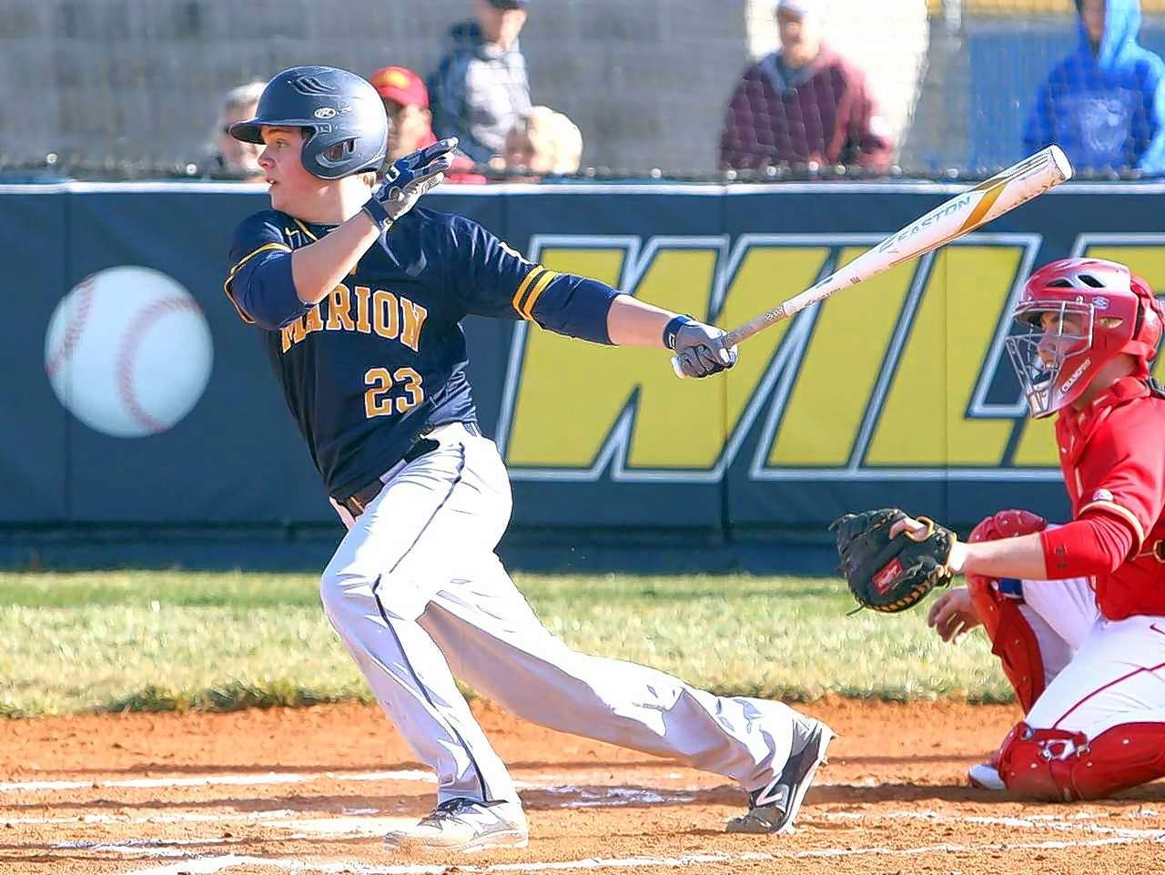 Jake Welch of the Wildcats rips a two-run single in the first inning.