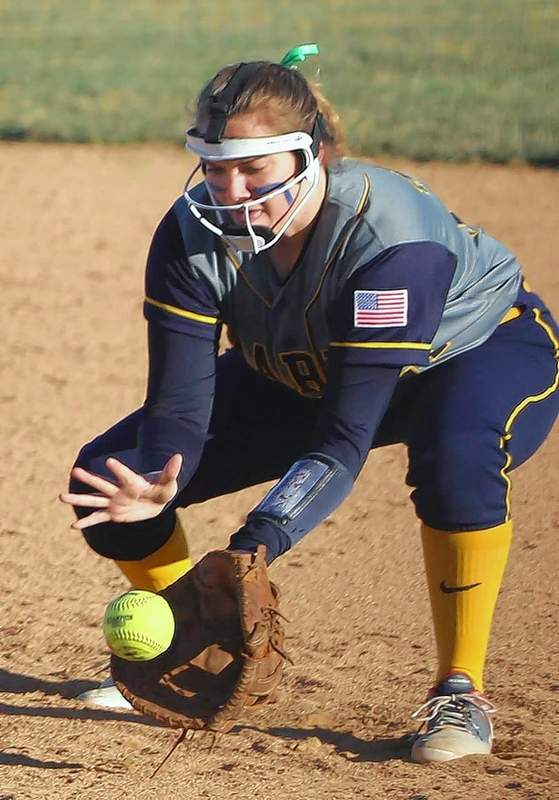 Marion first baseman Andrea Roberts fields a grounder cleanly and makes a putout.