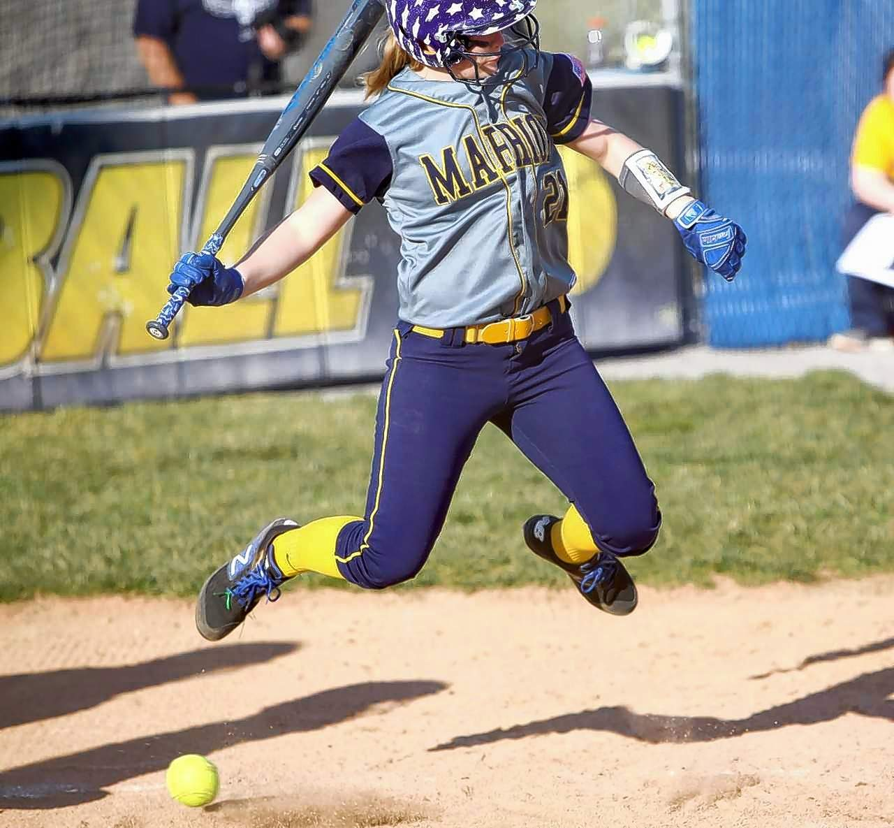 Marion's Karris Rhine jumps to avoid being hit by a pitch in game action Monday.