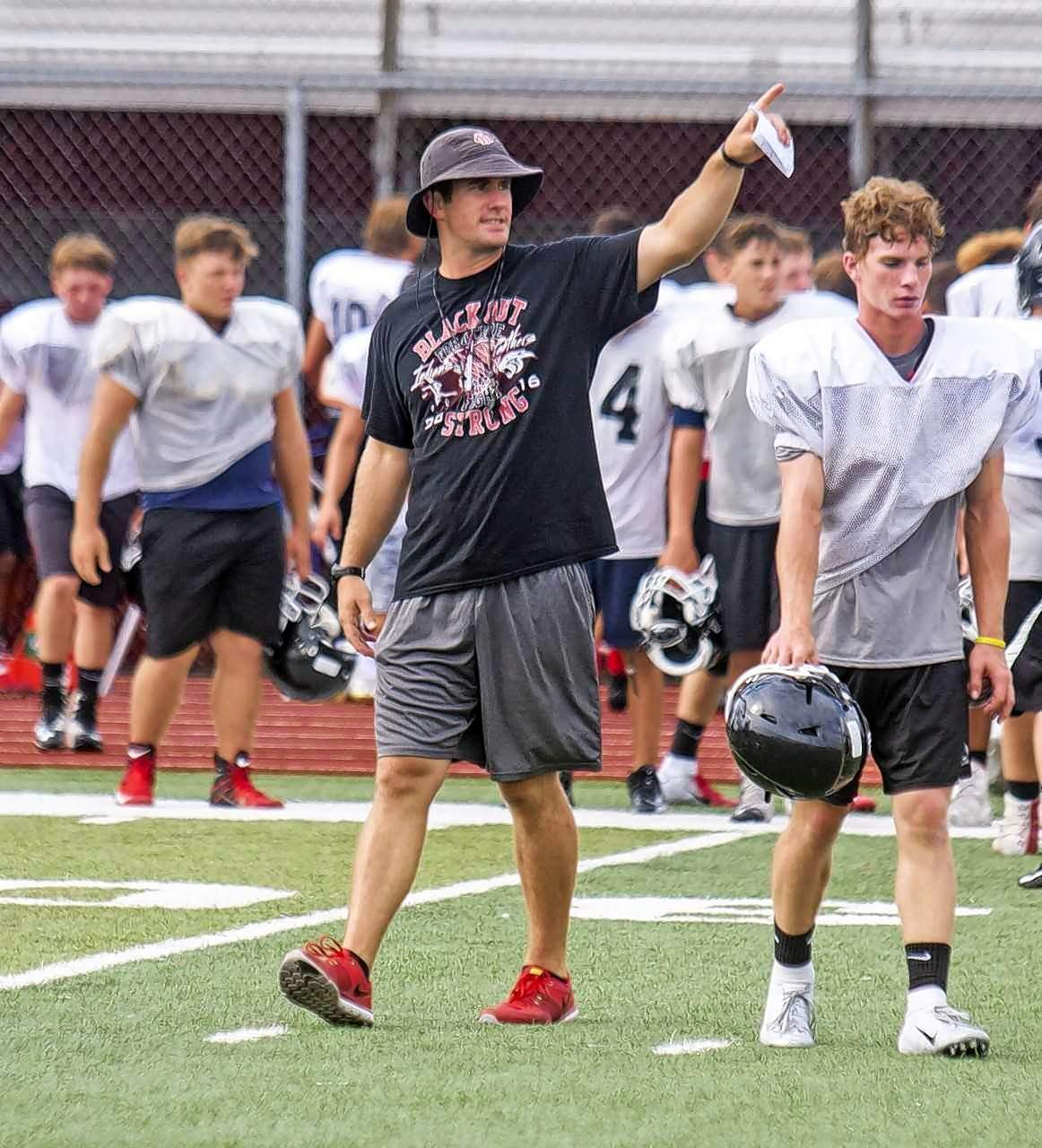 """Austin """"AJ"""" Hill has stepped down as head football coach of the Du Quoin Indians and will take a  teaching job at a Springfield-area school next school year. Here, he is shown coaching his players in summer workouts."""