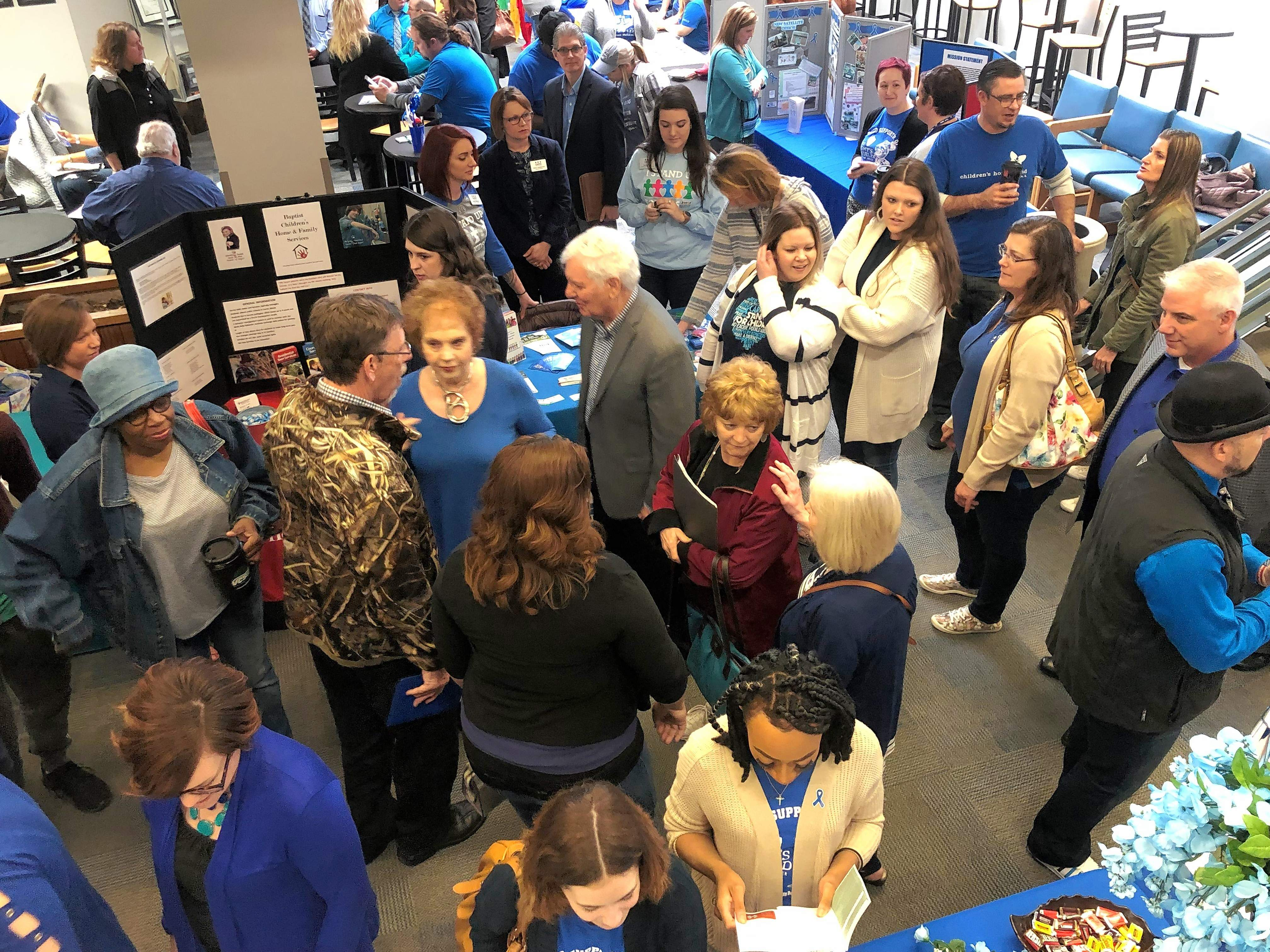 """Jo and Glenn Poshard, center, make their way through the crowd that gathered for the kickoff for """"Child Abuse Prevention Month,"""" hosted by the Poshard Foundation for Abused Children at John A. Logan College on Friday."""
