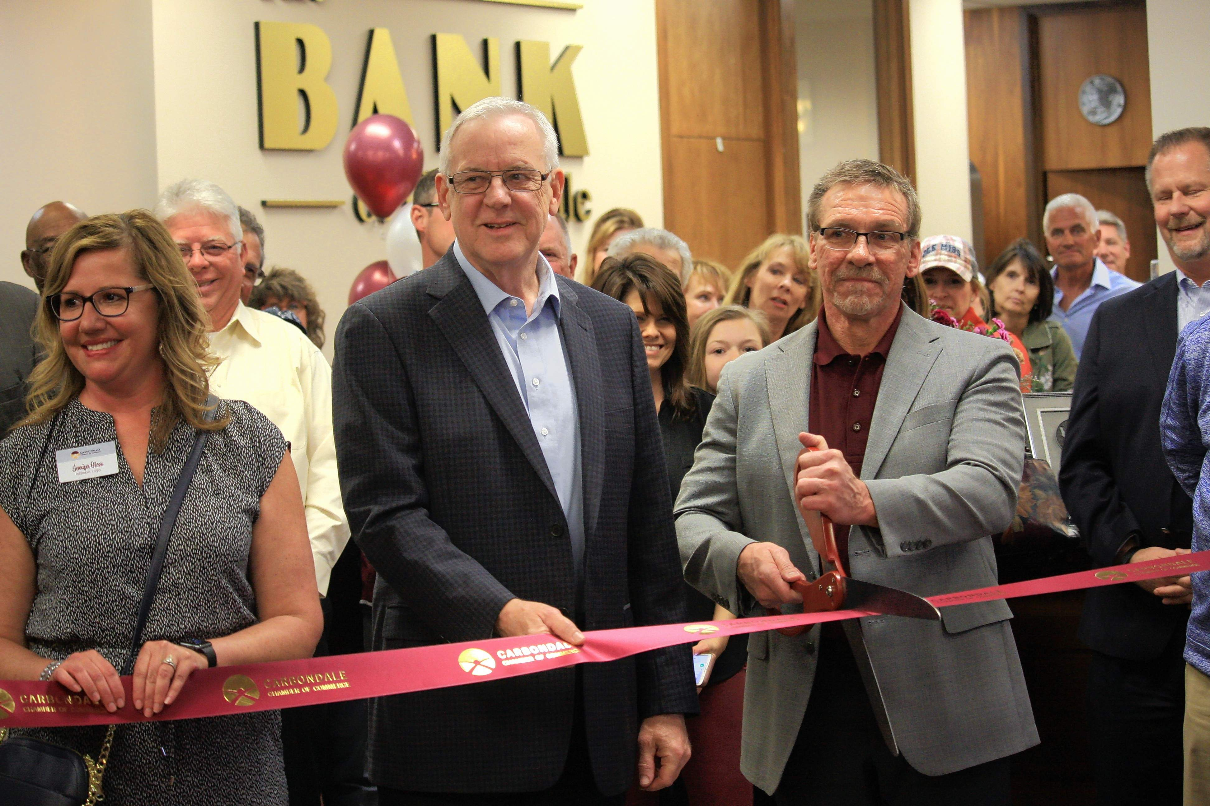 From left to right at last week's celebration are Jennifer Olson, CEO of the Carbondale Chamber of Commerce; Mayor Mike Henry; and Bob Bleyer, president of the Bank of Carbondale.