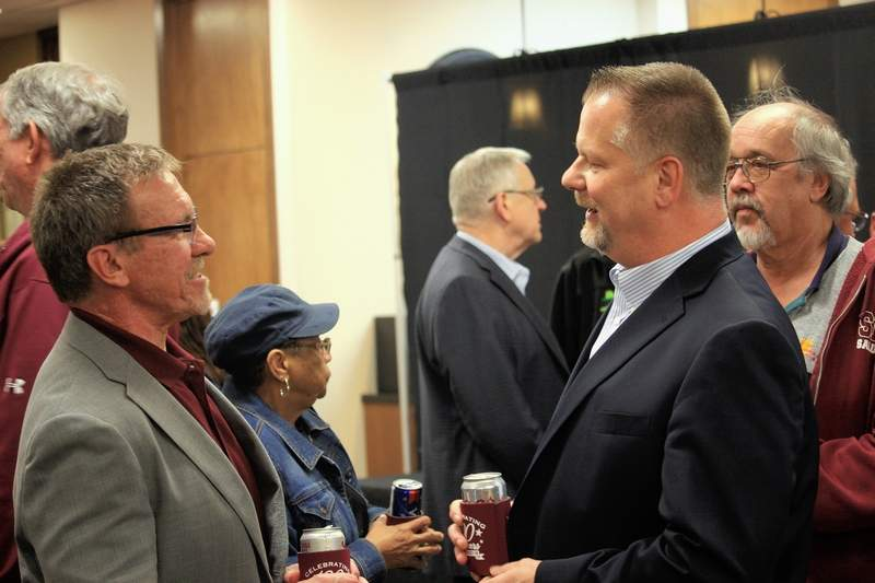 Bank of Carbondale President Bob Bleyer greets Steve Falat, general manager of River Radio, at last week's party celebrating the bank's 100th anniversary.