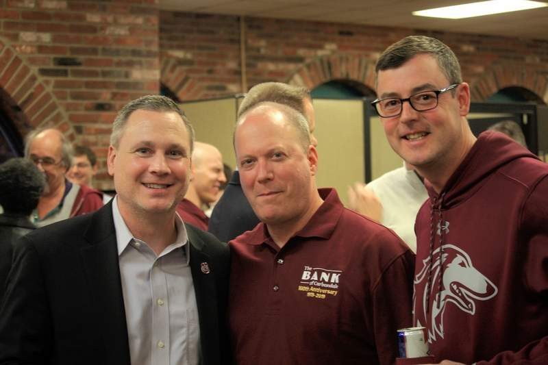 From left to right are Jason Fairfield, associate athletics director at SIU; Darren Berger, business development specialist at the bank; and Jimmy Karayiannis, owner of Pinch Penny Pub.