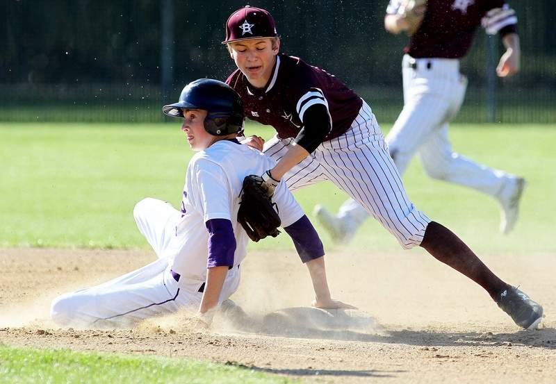 Harrisburg's Andrew Bittle slides safely into second base, ahead of the tag by Benton's Payton Bayless Tuesday in a SIRR Ohio road game. Bittle went 2-for-3 with two runs scored.