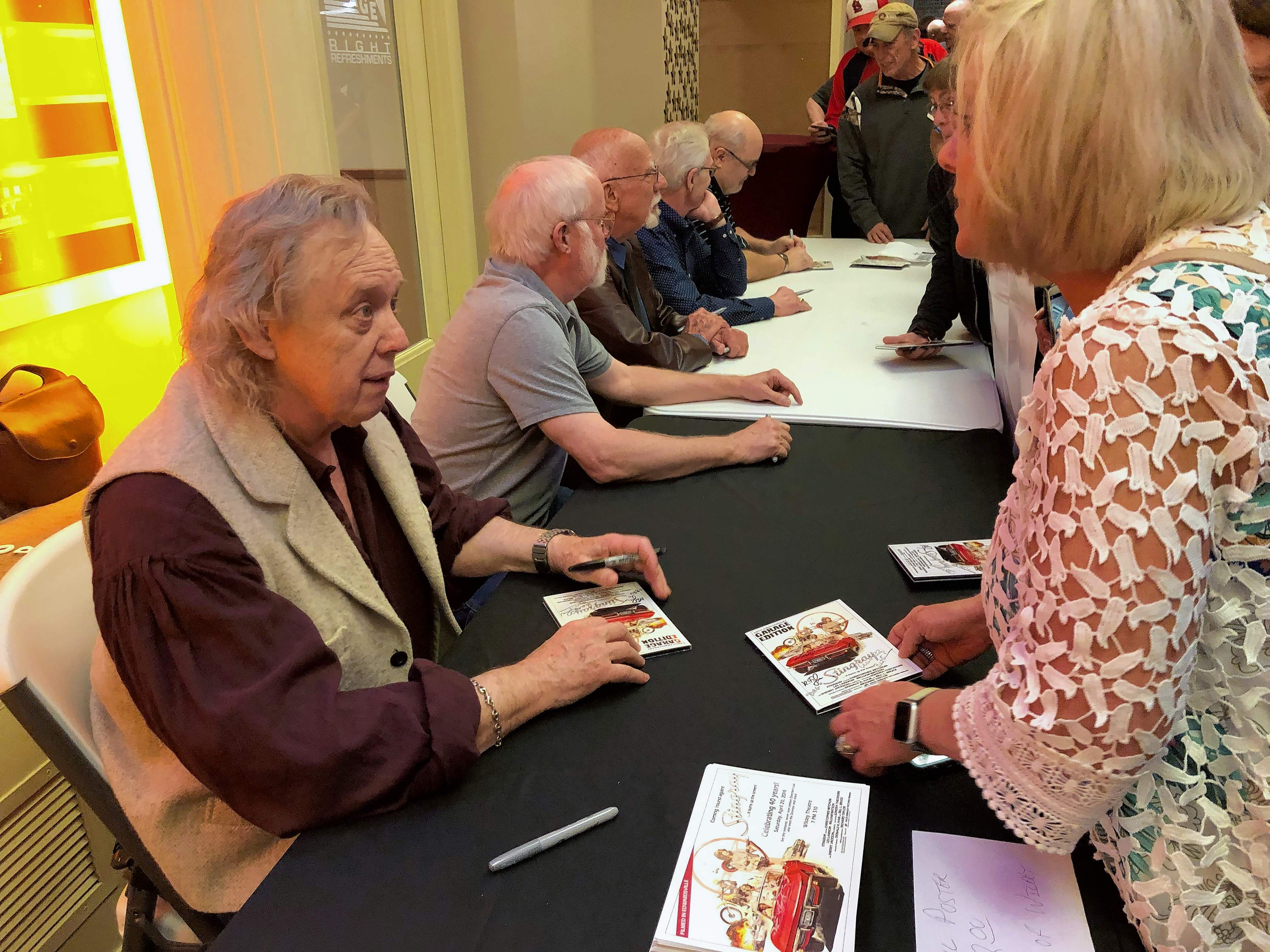 """Robin Payne of Bunker Hill chats with actor Les Lannom during a nearly two-hour autograph session following the screening of the 40th Anniversary """"Garage Edition"""" of the 1978 cult classic """"Stingray"""" in Edwardsville Saturday evening."""