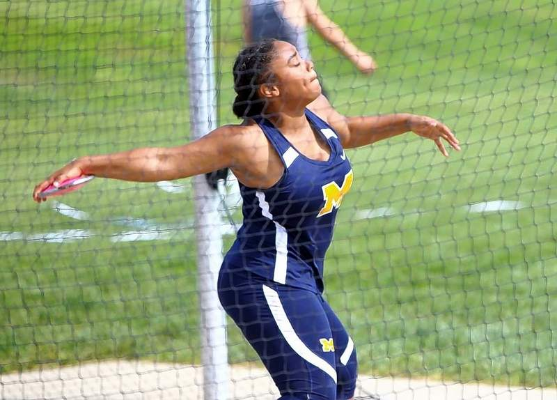 Maryiah Menicucci of the Wildcats prepares to make a throw in the discus event.