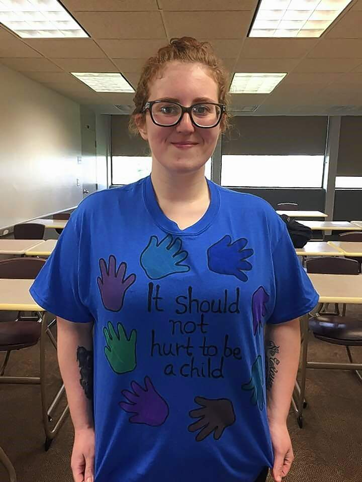 RLC student Sara Vaughn (Benton) shows off her blue shirt to raise awareness for Child Abuse Prevention Month in April.