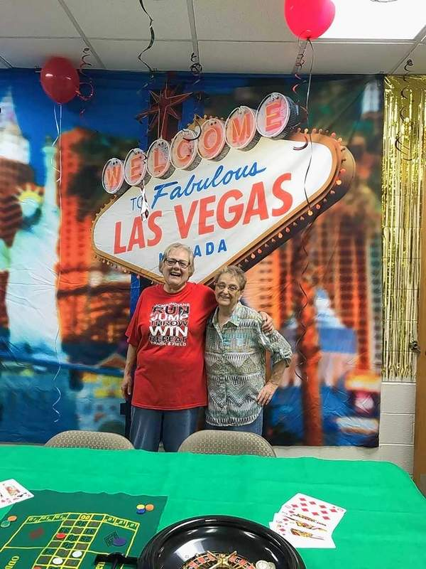 "Beth Roberts, left, and Betty McAnelly, finish transforming the Washington School lounge to ""Las Vegas."""