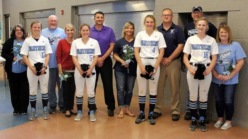 PCHS softball seniors recognized last Thursday are from left: Kiya Hagene with parents, Cheryl and Kevin; Lynlee Lindner with parents, Terri and Lonnie; Hallie Waggoner with parents, Lori and Bob; and Taylor Witges with parents, Kevin and Julia.
