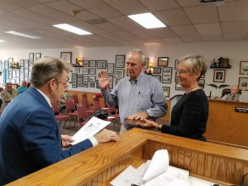 The newest addition to the Du Quoin City Council, Commissioner Bob Karnes, with wife, Pat, standing beside him, is sworn into office by City Attorney Aaron Atkins Monday.
