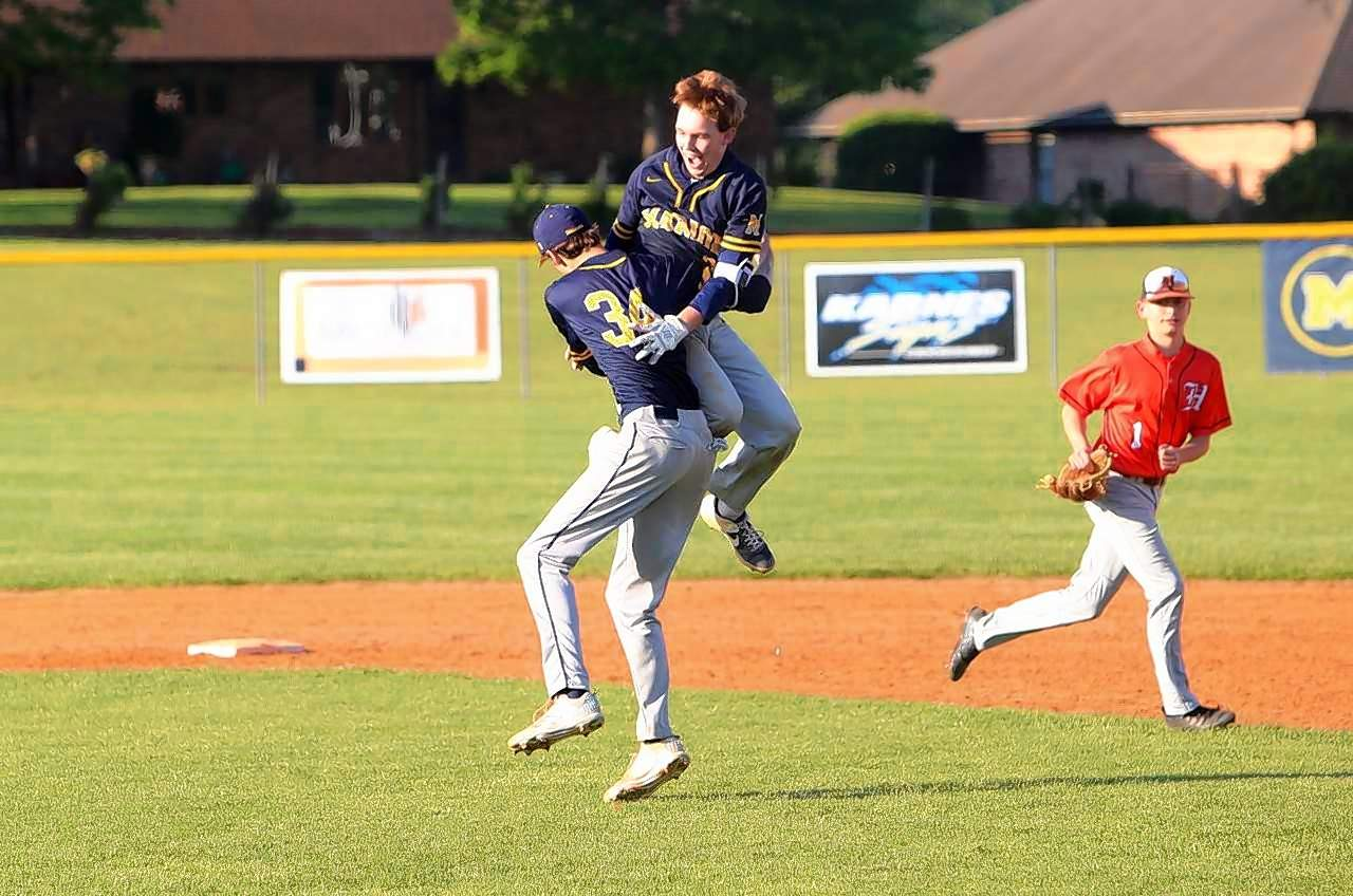 Marion's Ryan Trokey gets lifted by Mitchell Jackson after his game-winning hit Monday against Herrin.