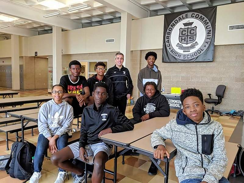 CCHS principal Ryan Thomas poses with the seven CCHS students tapped to be part of the SMASH Academy STEM program at the Illinois Institute of Technology this summer in Chicago. Pictured here are CCHS students Caleb Bondzi, DeShaun Daniels, Kenshon Ducksworth, Amarion Durham, Phillip Johnson, Ricky Madison and Jayla Ware.
