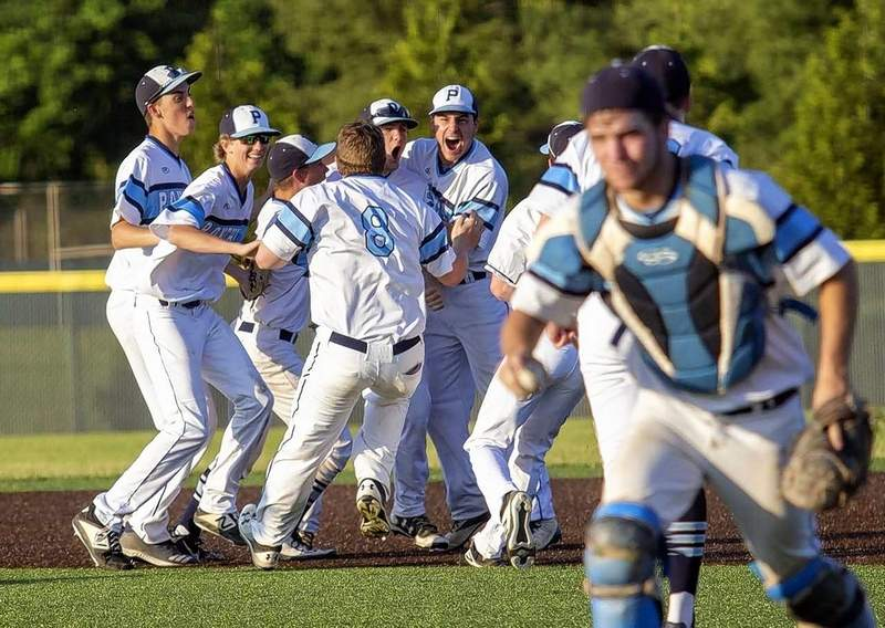 Pinckneyville High School players begin their celebration after knocking off Trico in extra innings Wednesday in semifinal round regional play at John A. Logan College.