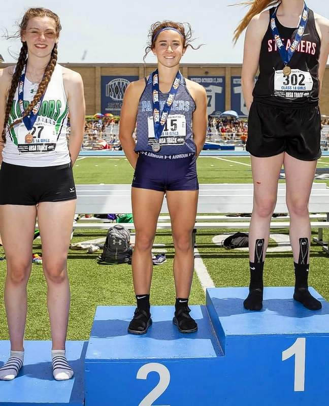 Pinckneyville's Dakota Krone receives her second place medal for the triple jump. She was also second in the long jump at state.