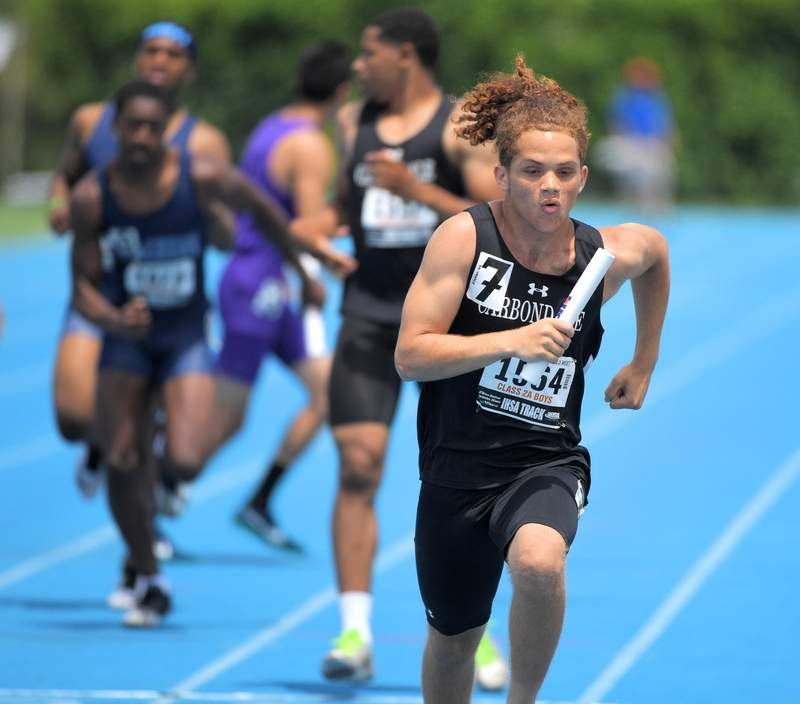 Carbondale's Isaac Martin runs the anchor leg in the Class 2A 1,600-meter relay at the IHSA boys state track preliminary events in Charleston Friday.