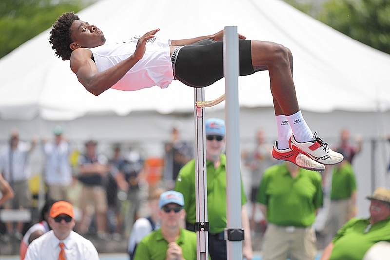 Carbondale's Martiez Pinnick clears the bar in the Class 2A high jump at the IHSA boys state track finals in Charleston last Saturday. Pinnick ultimately finished sixth in the state -- one of several recent strong finishes for tracksters at both Carbondale Community High School and SIU. FOR MORE, SEE PAGE 12.