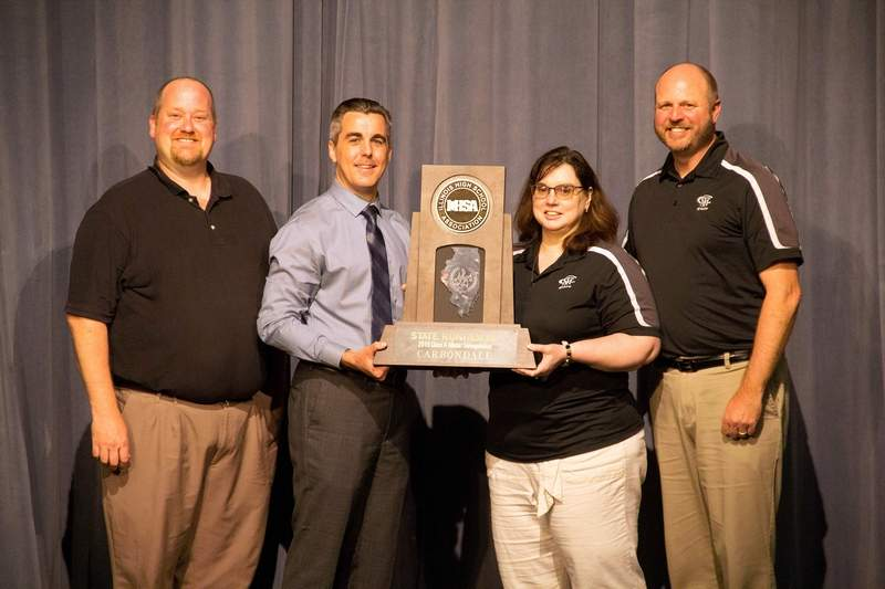 Courtesy of Gregory TownsendPictured with the trophy are CCHS faculty members (from left to right) fine arts department Chair Erik Berrey, Principal Ryan Thomas, choir director Rebecca Browning and director of instrumental music Gregory Townsend.