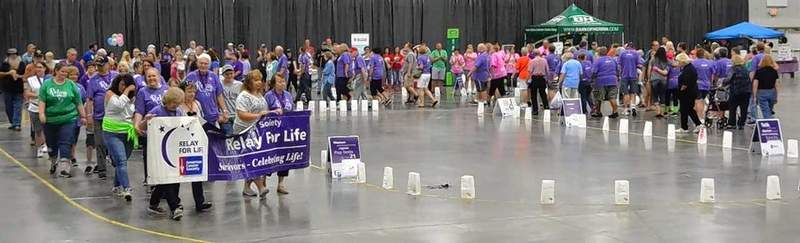 Cancer survivors and many of their caregivers take a victory lap during last year's American Cancer Society's Relay for Life event in  Marion. This year's event is set for Saturday at The Pavilion in Marion.