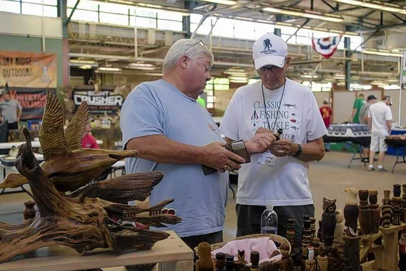 Glen Cottrell of Hopkinsville, KY. showed his hand-made laminate goose call to fowl hunting enthusiast John Guy of Du Quoin at the Southern Illinois Sportsmans Show Saturday at the fairgrounds.