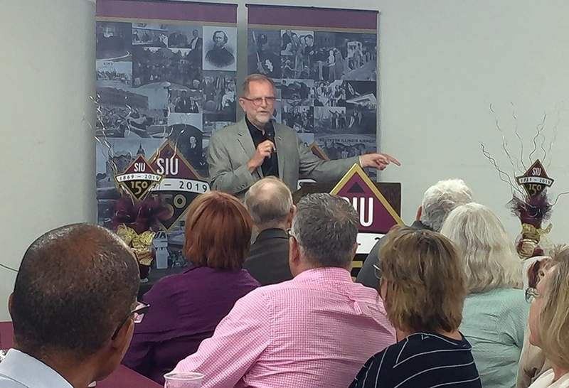 SIU Chancellor and Pinckneyville native John M. Dunn speaks about the university's 150th anniversary this past Thursday at the Pyramid State park Multipurpose Building. The university kicked off a statewide road show celebrating the anniversary.