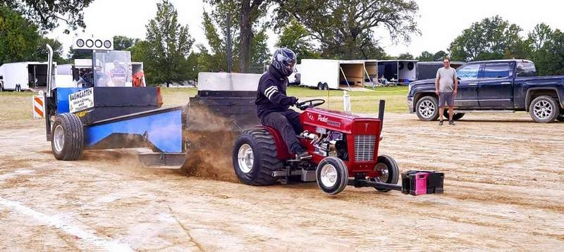 Nick Mishear, Washington, guided his powered-up garden tractor down the dirt track at the Williamson County Fairgrounds during the pulling competition Friday afternoon.