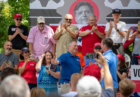 The crowd applauds as Congressmen Steve Scalise (left), R-Louisiana, and Rodney Davis, R-Illinios, get set to embrace Thursday during the Republican Day rally at the Illinois State Fair in Springfield. Davis introduced Scalise, who was the event's keynote speaker. Scalise had been to the area last year to campaign for Davis' successful re-election bid in the 18th Congressional District.
