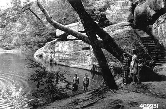 An early photo of Bell Smith Springs being used by swimmers.