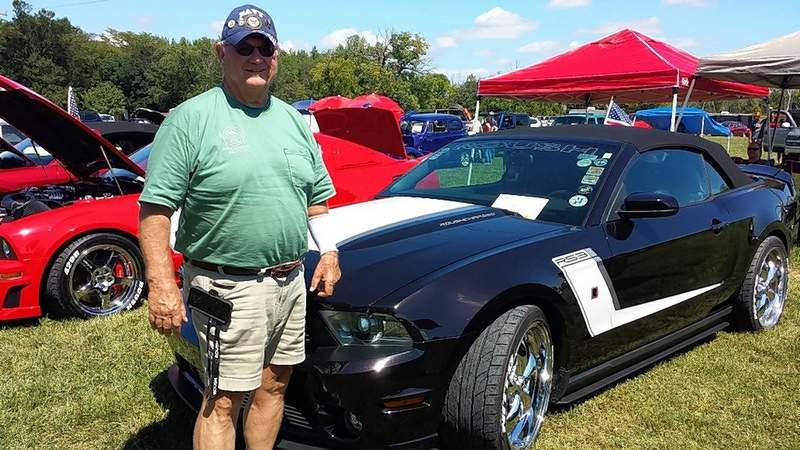 Jerry Main of Evansville, Indiana stands next to his 2012 Roush Mustang at the Memory Lane Car Show.