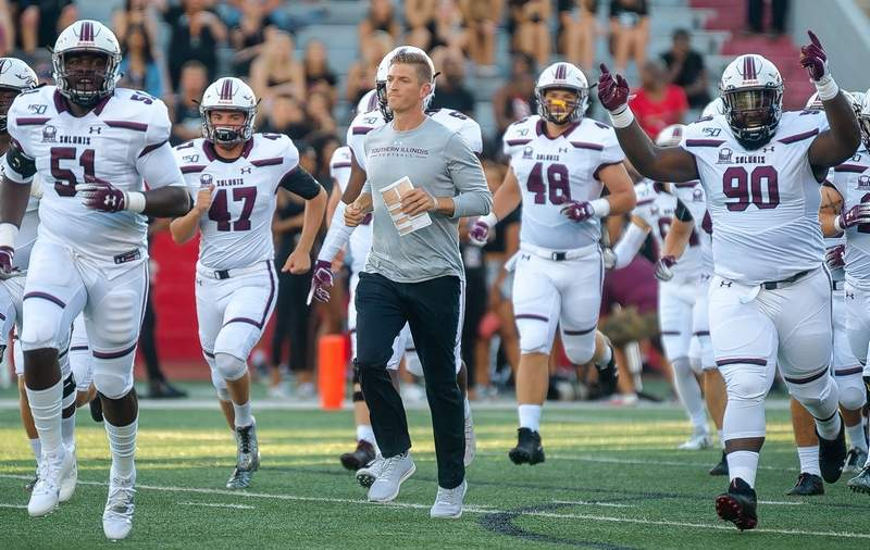 SIU head football coach Nick Hill leads the Salukis onto the playing field last Thursday at SEMO.