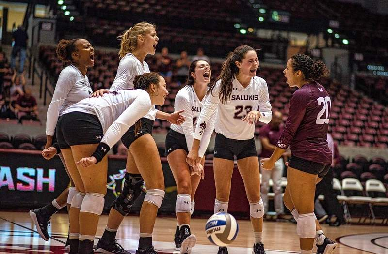 Saluki volleyball players celebrate a win last weekend at home.