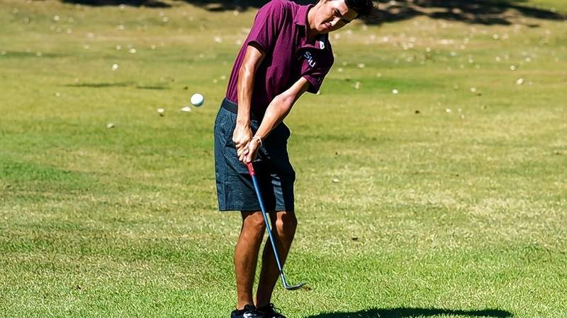 Saluki golfer Frankie Thomas works on his short game at the Graeme McDowell Invite in Birmingham, Ala. Monday. Thomas shot four-under-par and was in fourth place going into Tuesday's final round.