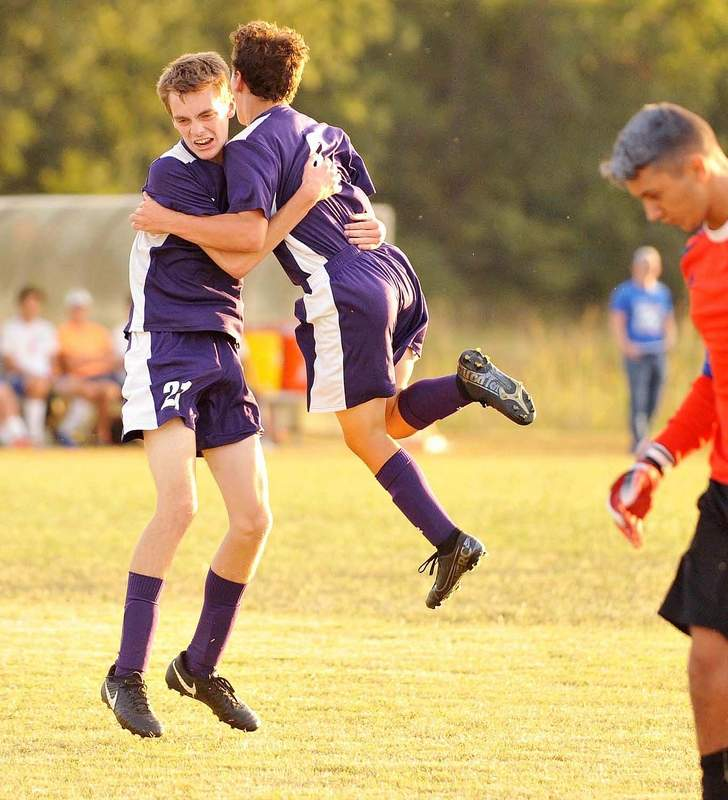 Bulldogs Nolen Bebout (left) and Jack Winters celebrate the goal scored by Winters in the second half of play against Massac County late last week.
