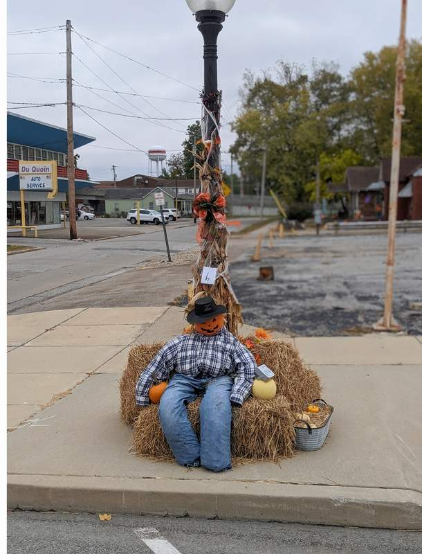 A scarecrow sits down on the job.