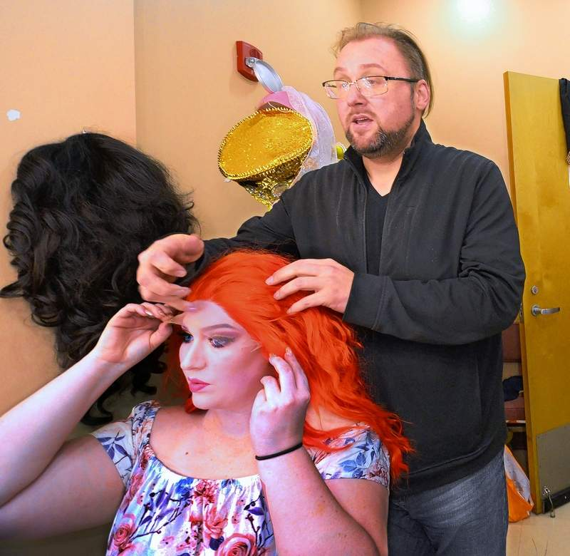 THE ROCKY HORROR SHOW director Derek Hamblin, Marion, adjusts the wig for actress Samantha Ridenour, Carterville, prior to curtain time at Marion Cultural & Civic Center for the popular show with performances set for tonight at 7 p.m. and again at midnight as well as the same times Saturday.