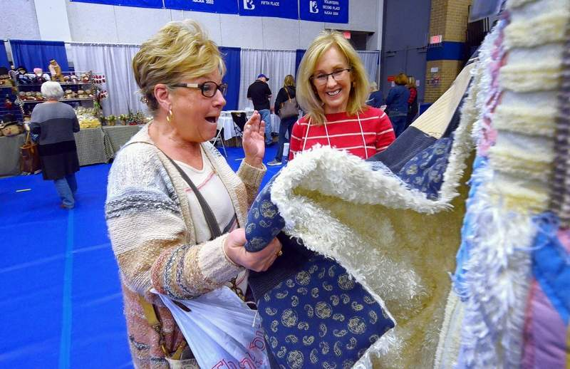 Mary Barrett of Marion, reacted with glee after closely inspecting this handmade quilt at DiAnne Hill's booth over the weekend at the John A. Logan College Gym, site of the 44th Annual AutumnFest.