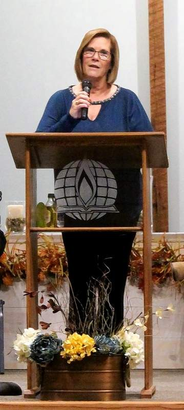 A Ministerial Alliance Lay Member, Jane Shelton from St. John's United Church of Christ, leads a Scriptural Responsive Reading.