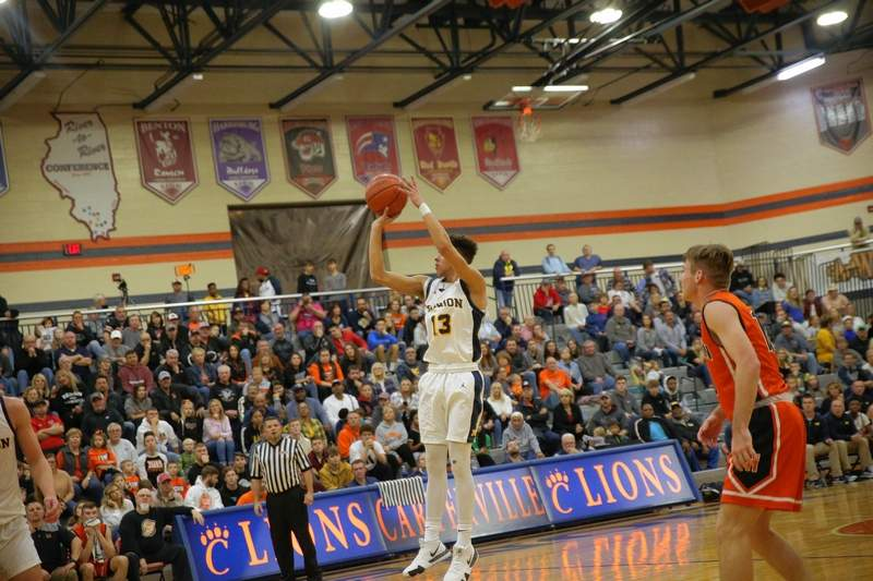 Rayzhaun Bardo finds himself alone and he attempts a three-pointer from the top of the arc in action against Herrin last week.