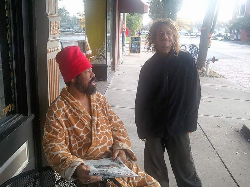 Tip Cook and Jason Tanner (right) mingle outside Global Gourmet in 2013.