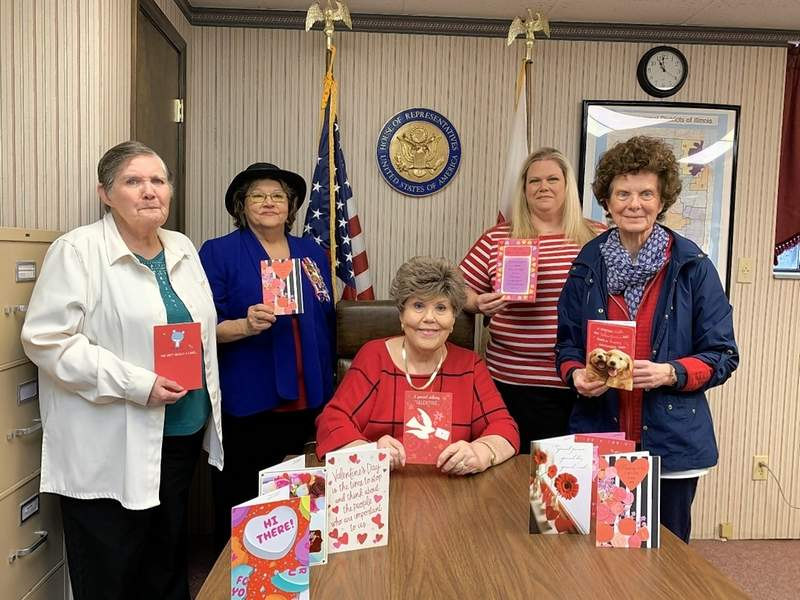 Michael Hillegas DAR Members presented more than 700 valentines for veterans for delivery. From left are Delores Vick, Shelia Albright, veterans chairman; (seated) Sharon L. Tanner, regent; Kristen Shull, U.S. Rep. John Shimkus' office manager, and Candy Duncan Evans.