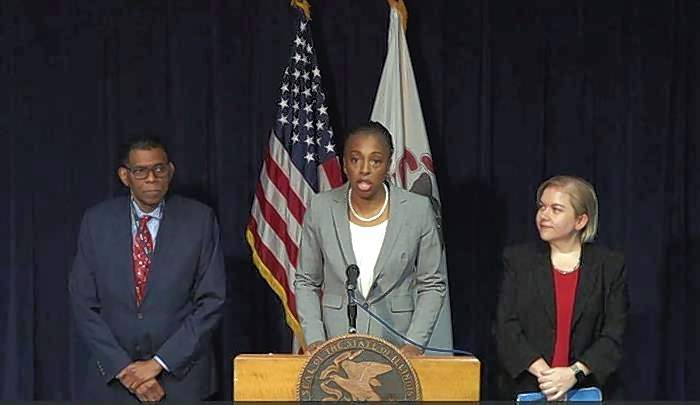 "Dr. Ngozi Ezike, center, director of the Illinois Department of Public Health, said in a news release Wednesday the department is working to coordinate ""a robust response"" to coronavirus."
