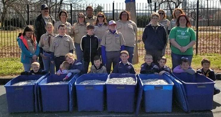 Cub Scout Pack 316 shows off the collection before donating the tabs to Ronald McDonald House.