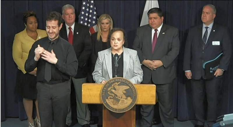 """Illinois Superintendent of Education Carmen Ayala speaks at Friday's news conference. """"We are here to do anything and everything we can to help our schools and our students get through this crisis,"""" Ayala said."""