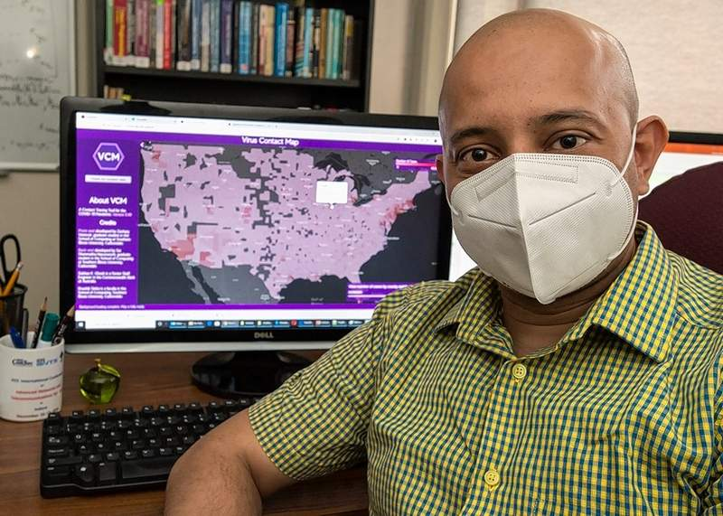 Koushik Sinha, an assistant professor in the School of Computing at SIU, works on the Virus Contact Map, a new tool he and his team are developing to track COVID-19 and assist public health officials and the general public while protecting individual privacy. Once populated with the proper data and synced with common GPS information, the Virus Contact Map (VCM) would provide an important tool for tracking the virus' spread.