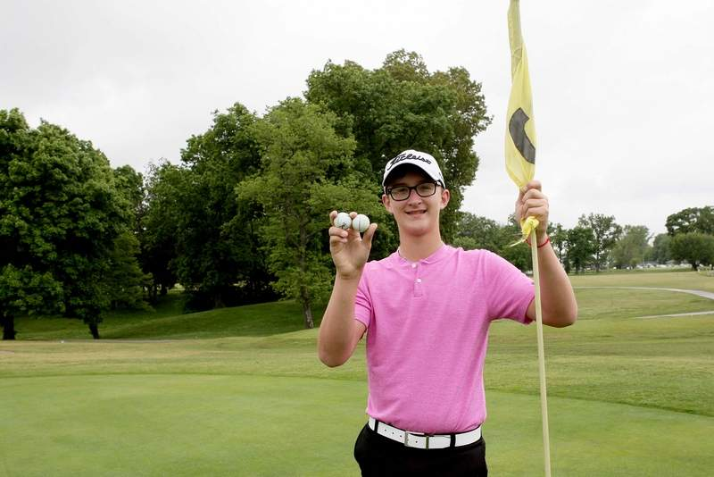 Cy Norman, from Benton, poses with the two hole-in-one balls from Monday's round at Benton County Club. Norman aced the par-3 No 4 and No. 7, giving him a total for four aces in his lifetime. Norman is 15 and will be a sophomore at Benton High School.