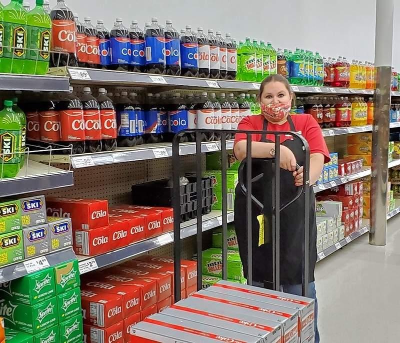 Save A Lot Manager Jessica Ralston restocks shelves.